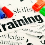stock-photo-15560128-newspaper-headlines-about-the-value-of-training-plus-pens